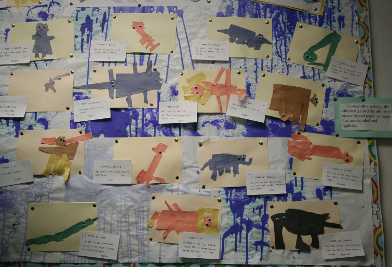 bulletin board display of torn paper animal art