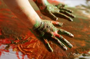 Children artist hands painting colorful