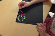 dots on black paper