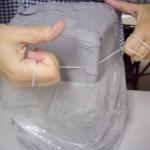 cutting block of clay
