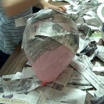 covering balloon with paper mache mush