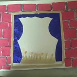 Menorah on window with brick wall