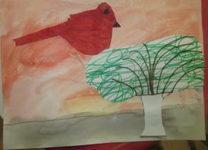 red bird in tree
