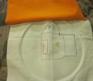 embroidered pillow  being sewn